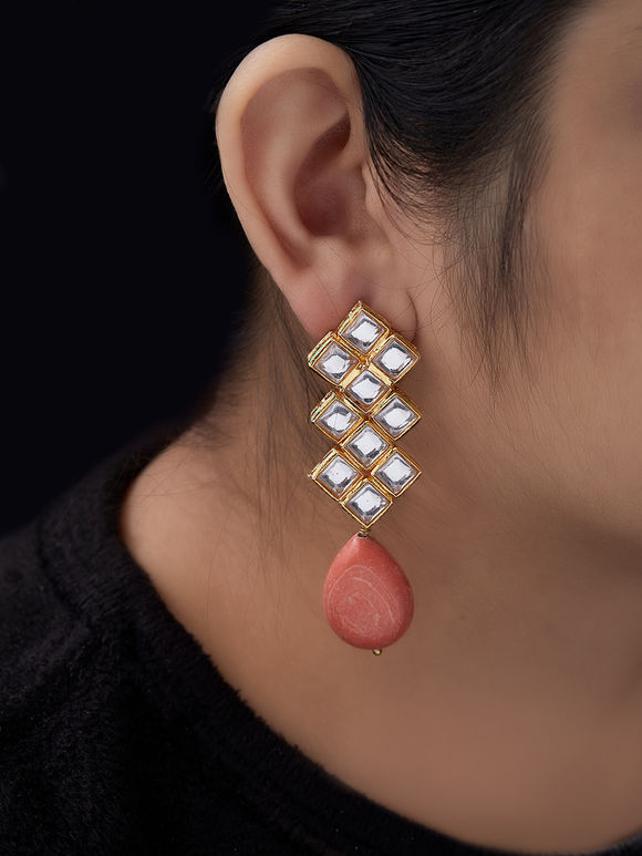 Orange Kundan Studs Metal Earrings